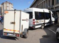 Mini van with luggage trailer