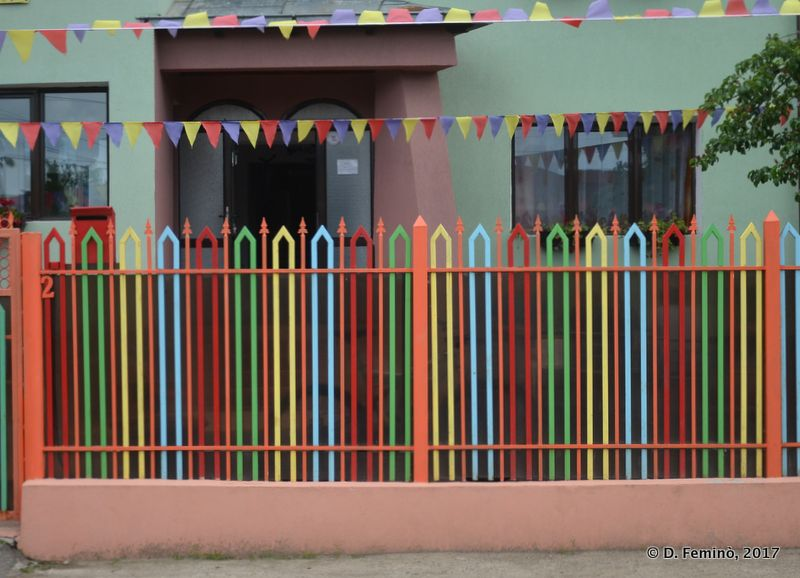 Colourful fence in a school (Iași, Romania, 2017)