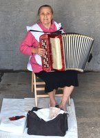 Lady playing the accordion