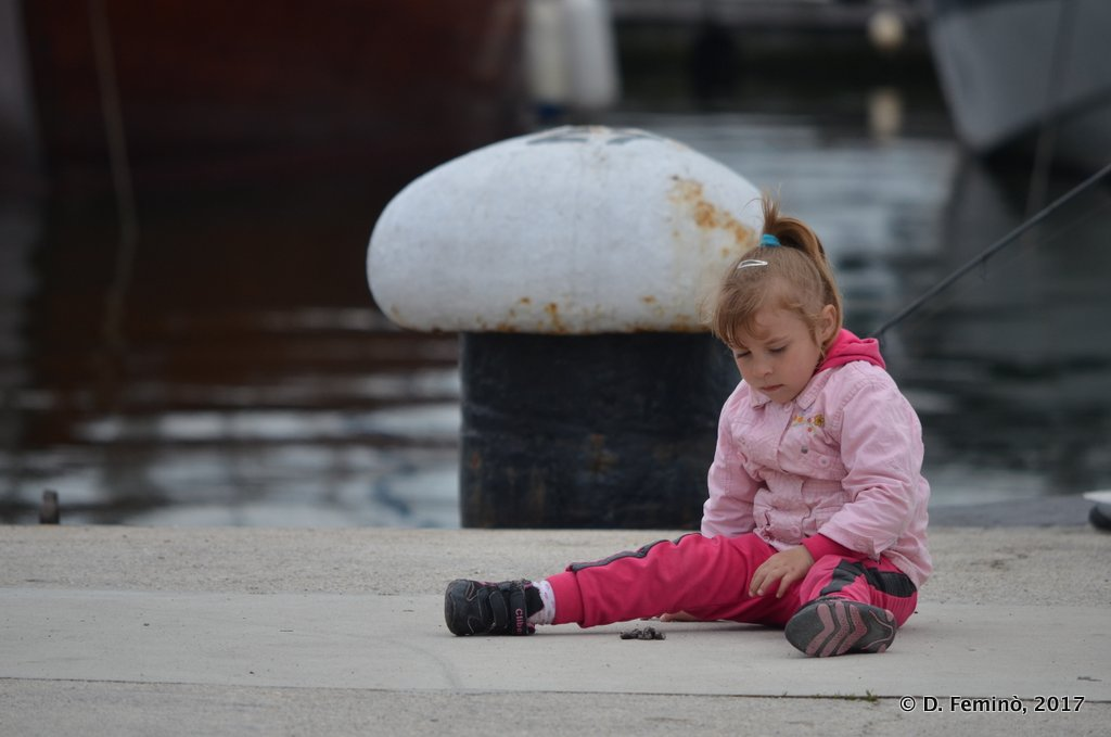 Varna, Bulgaria, Little girl by a bollard