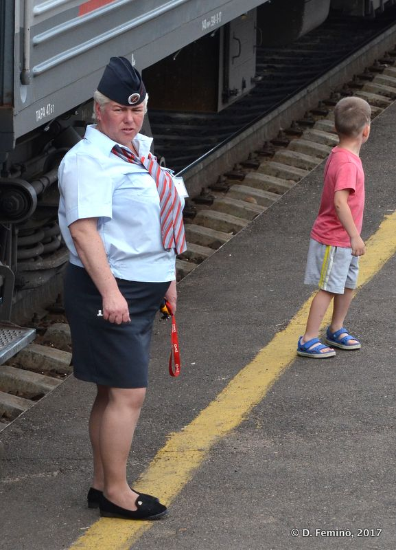 A conductor guarding her coach