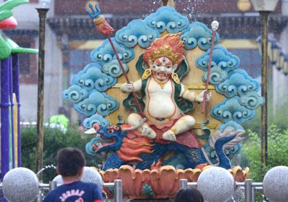 Deity statue in the rain
