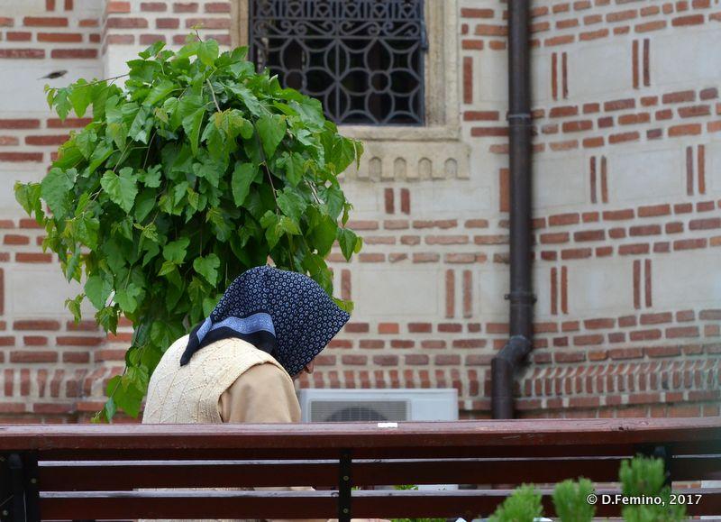Lady outside a church (Bucharest, Romania, 2017)