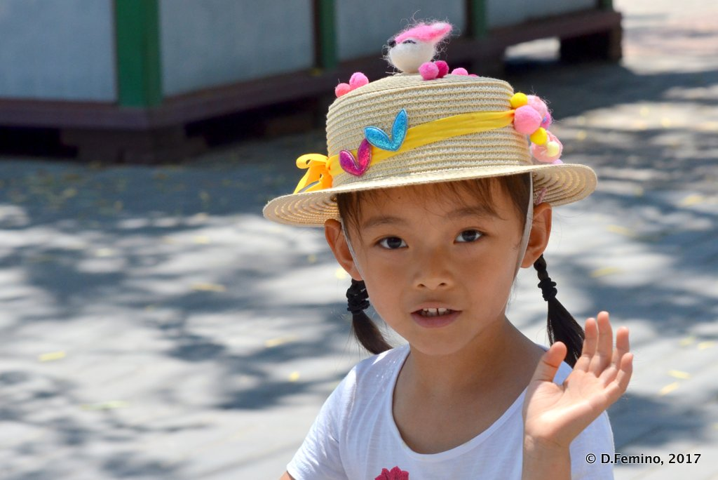 A Chinese girl with a funny hat