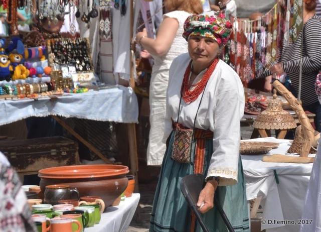 Woman in traditional dress at flea market (Kiev, Ukraine, 2017)