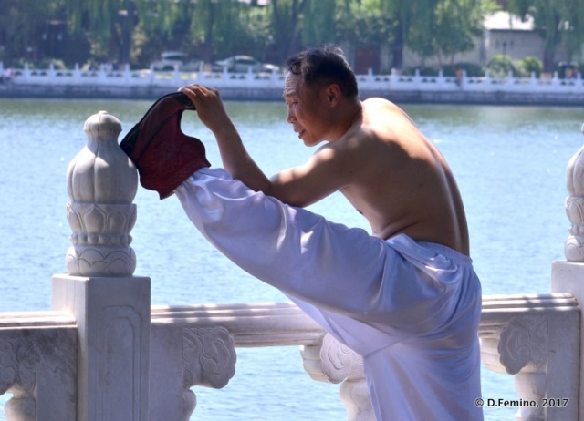 Doing gymnastics by Qianhai lake (Beijing, China, 2017)