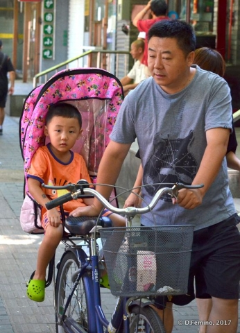 On the bicycle with a passenger (Beijing, China, 2017)