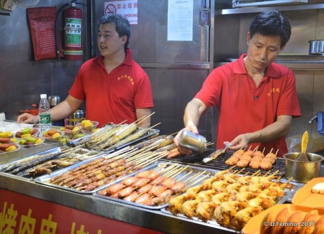 Serving skewers (Beijing, China, 2017)