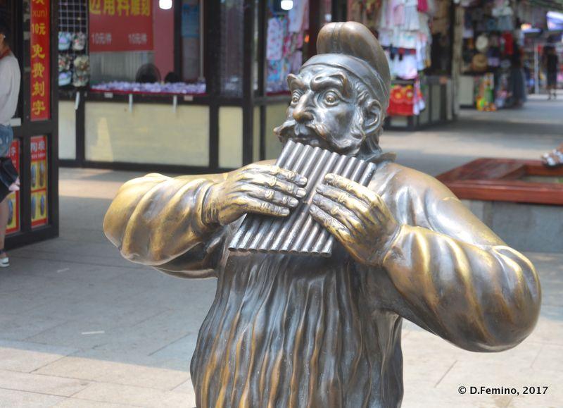 Pan flute player statue (Xi'an, China, 2017)